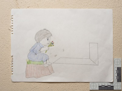 """""""A girl at her father's grave."""" Drawing by Syrian girl."""